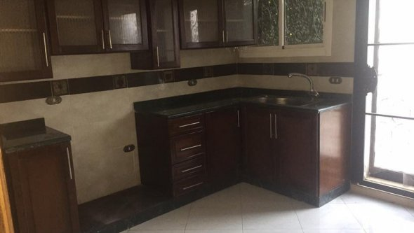 townhouse for rent in compound Mena garden City
